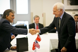 Turkish president Abdullah Gul (left) greets MIT Vice President Claude Canizares (right) in MIT's Building 10 on May 30.