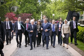 Turkish president Abdullah Gul (right-center) and MIT Vice President Claude Canizares (left-center) lead a delegation from Turkey through the MIT campus.