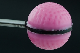 Researchers made this sphere to test their concept of morphable surfaces. Made of soft polymer with a hollow center, and a thin coating of a stiffer polymer, the sphere becomes dimpled when the air is pumped out of the hollow center, causing it to shrink.