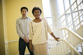 MIT professor Paula Hammond (right) and Bryan Hsu PhD' 14 have developed a nanoscale film that can be used to deliver medication, either directly through injections, or by coating implantable medical devices.