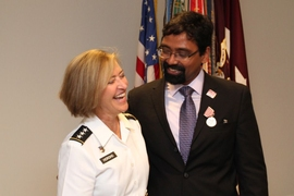 Jayakanth Srinivasan stands with Army Surgeon General Patricia Horoho after receiving the U.S. Army's Outstanding Civilian Service Medal on June 27.
