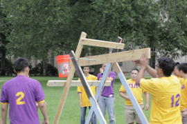 Pi Lambda Phi created a catapult for the Ice bucket challenge, which soaked President Reif a second time.