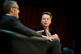 Jaime Peraire, left, AeroAstro department head and H.N. Slater Professor of Aeronautics and Astronautics, speaks to Elon Musk, CEO and co-founder of SpaceX and Tesla.