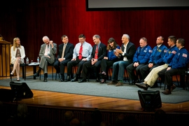MIT AeroAstro professor Dava Newman (left) moderates a Q&A session with MIT professor Jeffrey Hoffman and MIT alumni astronauts, including (in alphabetical order) Dominic Antonelli, Kenneth Cameron, Christopher Cassidy, Catherine Coleman, Franklin Chang-Diaz, E. Michael Fincke, Jack Fischer, John Grunsfeld, and Michael Massimino.