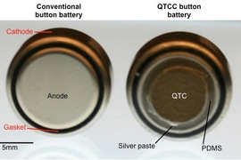At left, a typical button battery; at right, a button battery coated with quantum tunneling composite (QTC).