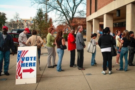 A line of voters stand at the end of a line with a two-and-a-half-hour wait to vote Nov. 3, 2008, in downtown Newark, Ohio.