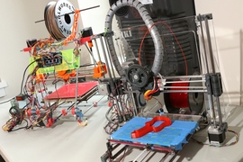 Two RepRap 3-D printers built by Spielberg.