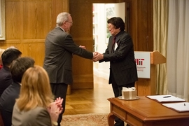 MIT President L. Rafael Reif shakes hands with Samuel Tak Lee at the signing ceremony formalizing Lee's gift to MIT. The gift will create a new Samuel Tak Lee MIT Real Estate Entrepreneurship Lab and result in the renaming of MIT's Building 9 as the Samuel Tak Lee Building.