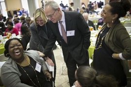 MIT president Rafael Reif and his wife Christine share a light moment with attendees at the MLK Jr. luncheon.