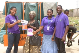 A local woman exchanges points she earned for recycling through Wecyclers for food.