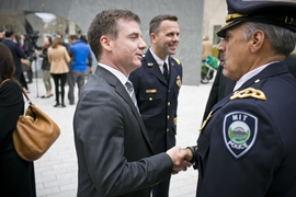 Israel Ruiz, MIT's Executive Vice President and Treasurer (center), shook hands with John DiFava, MIT's director of campus services and chief of police, following the dedication ceremony.