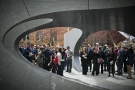 The smooth, curved vault of the granite memorial is supported by five radial walls. Members of the MIT community gathered around and inside the structure following today's ceremony.