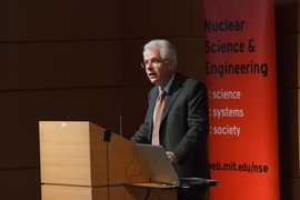 Richard Lester, head of MIT's Department of Nuclear Science and Engineering, introduces Hansen.