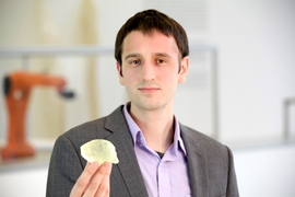 Graduate student Steven Keating holds a 3-D-printed copy of his cancerous astrocytoma brain tumor. It was printed by Keating with data from Brigham and Women's Hospital.