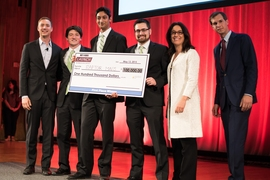 (From left) MIT $100K co-director Marc Chalifoux; RaptorMaps team members Eddie Obropta, Nikhil Vadhavkar, and Forrest Meyen; event host Krisztina Holly; and MIT $100K co-director Jacob Auchincloss.