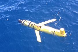 A Slocum glider, used by the MIT team, navigates underwater.