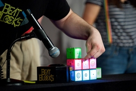 Beat Blocks are color coded, and each block produces a drumbeat, bass line, or melody when snapped onto a base unit.
