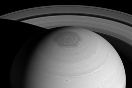 The rings of Saturn and its north polar vortex.