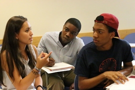 Members of the Geometers team (from left) Tiffany Buman, Evan Fenton and Trajan Hammonds, confer on a problem.
