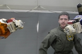 MIT Space Systems Laboratory graduate student Duncan Miller carries out tests of SPHERES satellites with the Universal Docking Port on a flight aboard NASA's reduced gravity aircraft in 2014.