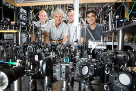 The Ketterle Group is working with lasers to create superfluids at MIT. Pictured, from left to right: grad student Colin Kenned, Professor Wolfgang Ketterle, grad student William Cody Burton, and grad student Woo Chang Chung.