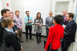 "Pritzker meets with Professor Dina Katabi (center) and graduate students Zachary Kabelac (purple shirt) and Fadel Adib (green shirt), along with other officials, ahead of her remarks. Katabi, Kabelac, and Adib participated in the White House's first annual ""Demo Day"" to promote innovation and entrepreneurship, presenting a wireless motion-tracking device they invented."