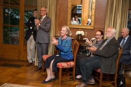 Hockfield with President L. Rafael Reif (standing, to her right) at the portrait's unveiling.