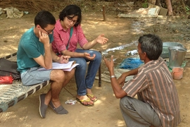 Eshita Dayani from the Indian Institute of Management-Ahmedabad and Jonars Spielberg from MIT CITE interview a local resident about his water quality and water filter usage in Ahmedabad, India.
