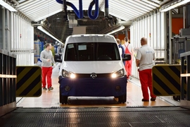 Workers inspect a car on the production line in a Volkswagen factory in Poznan, Poland.