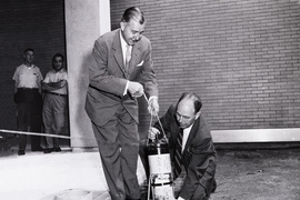 "A 1957 photograph shows President James R. Killian Jr. (left) and professor of electrical engineering Harold ""Doc"" Edgerton burying the time capsule."