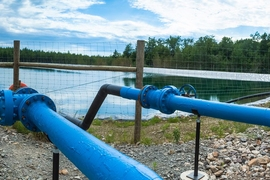 Researchers say the new desalination method could be useful for cleaning the contaminated water generated by hydraulic fracturing, or fracking. Shown here is a holding pit for fracking water.