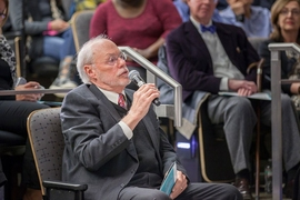 MIT Institute Professor Phillip Sharp asks a question after the lecture.