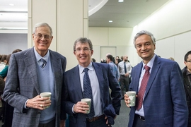 David H. Koch '62, SM '63, Killian Award recipient Tyler Jacks, and Krishna Rajagopal, chair of the MIT faculty, at a reception following the Killian Lecture.