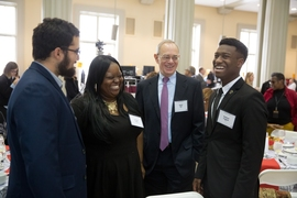 (Left to right) Alberto Hernandez, La-Tarri Canty, President Rafael Reif, and Rasheed Auguste have a conversation before the luncheon.