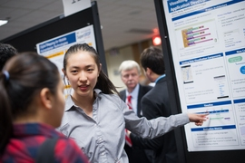 "Course 6 junior Ashley Wang presents her project, ""Visualizing Big Data in Mobile Application Development,"" at the SuperUROP Research Preview in December."