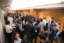 Students gathered at a reception after the SuperUROP Research Preview.