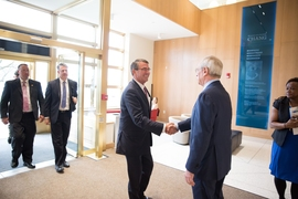 President L. Rafael Reif (right) greets Secretary of Defense Ashton Carter Friday morning at the Sloan School of Management at MIT.
