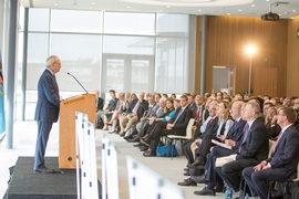 Rafael Reif addresses the crowd assembled in the Samberg Conference Center at MIT. The event announced that an independent nonprofit founded by MIT has been selected to run a new $317 million public-private partnership designed to accelerate innovation in high-tech, U.S.-based manufacturing involving fibers and textiles.