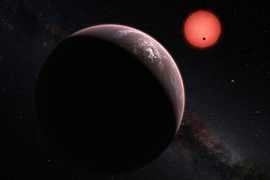 This artist's rendering shows an imagined view of the three planets orbiting an ultracool dwarf star just 40 light-years from Earth that were discovered using the TRAPPIST telescope at ESO's La Silla Observatory. In this view, one of the inner planets is seen in transit across the disc of its tiny and dim parent star.