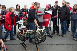 MIT's robotic cheetah marches along the bridge.
