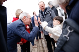 MIT President L. Rafael Reif high-fives a young spectator.