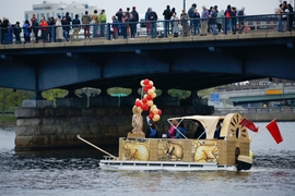 "The ""Bucentaur 2016"" makes its way across the Charles River."