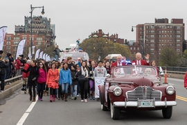 "MIT's ""Crossing the Charles"" procession and competition was a featured part of the Institute's Moving Day festivities, May 7, 2016. Here, grand marshall Oliver Smoot '62 (right) rides at the front of the parade."