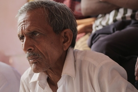 In a rural village outside of Jalgaon, India, a farmer meets with Professor Amos Winter and PhD student Natasha Wright SM '14 to explain how the cost of kidney stones, which are caused by drinking brackish water and in some situations can cost up to 20,000 rupees per year in medical bills, affect his finances.