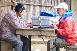 Brandeis University professor Ricardo Godoy conducts the experiment in a village in the Bolivian rainforest. The participants were asked to rate the pleasantness of various sounds, and Godoy recorded their response.