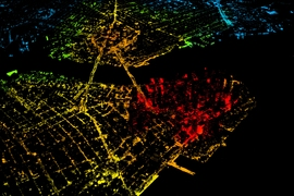 "Nighttime image of New York City, with the red showing a large population density. ""The adoption potential of electric vehicles is remarkably similar across cities, from dense urban areas like New York, to sprawling cities like Houston. This goes against the view that electric vehicles — at least affordable ones, which have limited range — only really work in dense urban centers,"" says Jes..."