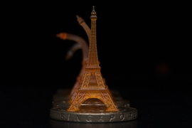 A shape memory Eiffel tower, pictured, was 3-D printed using projection microstereolithography. Here you can see it recovering from being bent after toughening on a heated Singapore dollar coin.