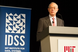 "President L. Rafael Reif speaks at the Institute for Data, Systems, and Society (IDSS) showcase. In his remarks, Reif noted that IDSS is ""a unit that can magnify individual talents through collaborations, a unit that aspires to generate groundbreaking ways to understand society's most difficult problems and lead us to badly-needed solutions."""