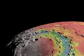 This image shows free-air gravitational anomalies and a shaded topographic relief of the Moon's 930-km-diameter Orientale impact basin. Red corresponds to mass excesses and blue to mass deficits relative to a reference value. This gravitational field model, based on measurements acquired from the NASA GRAIL mission, shows the detailed structure of the central basin depression that is filled with...