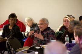 Ayida Mthembu, associate dean of Student Support Services, asks a question during the Dec. 14 luncheon.